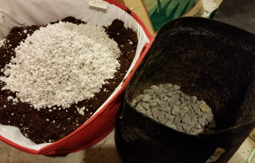 Prepare your coco for your weed clones by adding a layer of rocks for drainage and amending the coco coir with perlite.